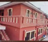 Two plots of land and a one storey building hostel for sale