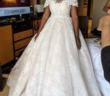 A size 12 Ivory ball wedding dress